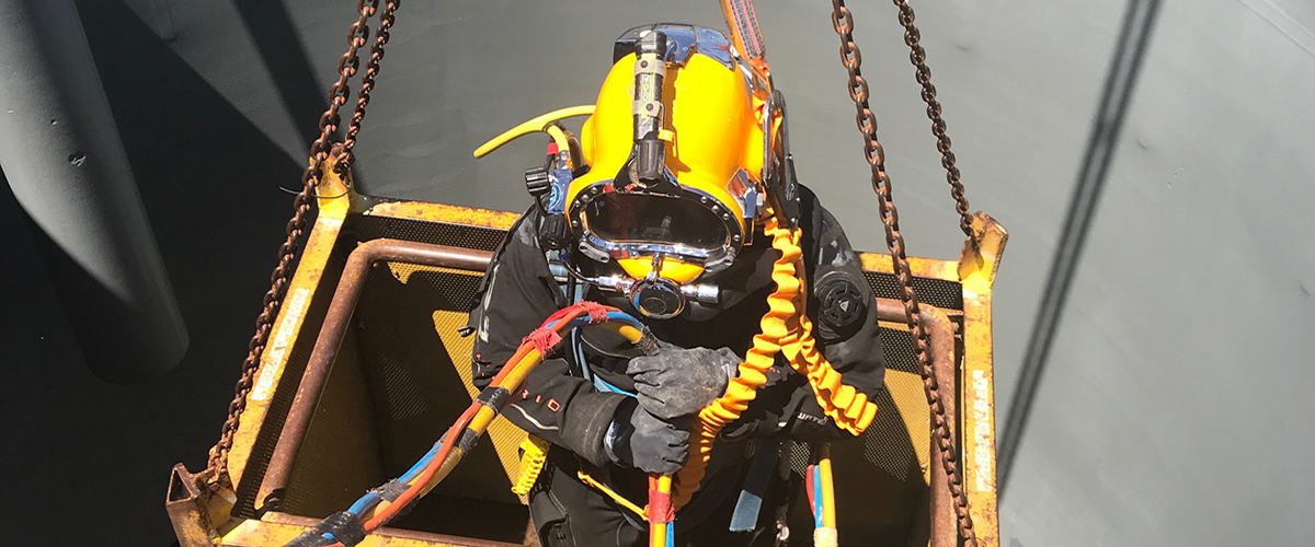 Occupational Diver lowered into water treatment plant