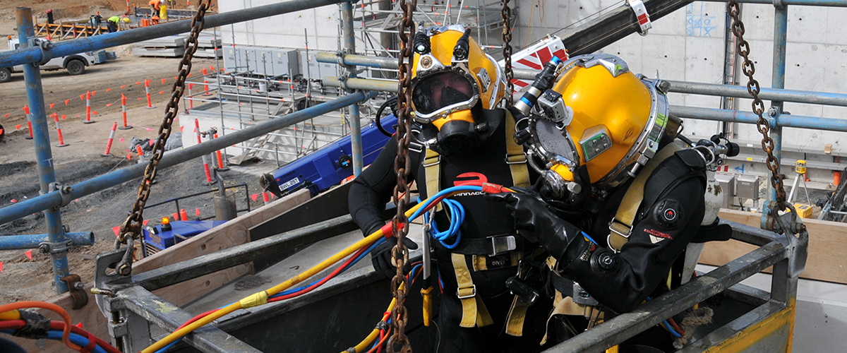 Occupational divers with SSBA equipment