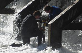 Crew inspecting a Weir