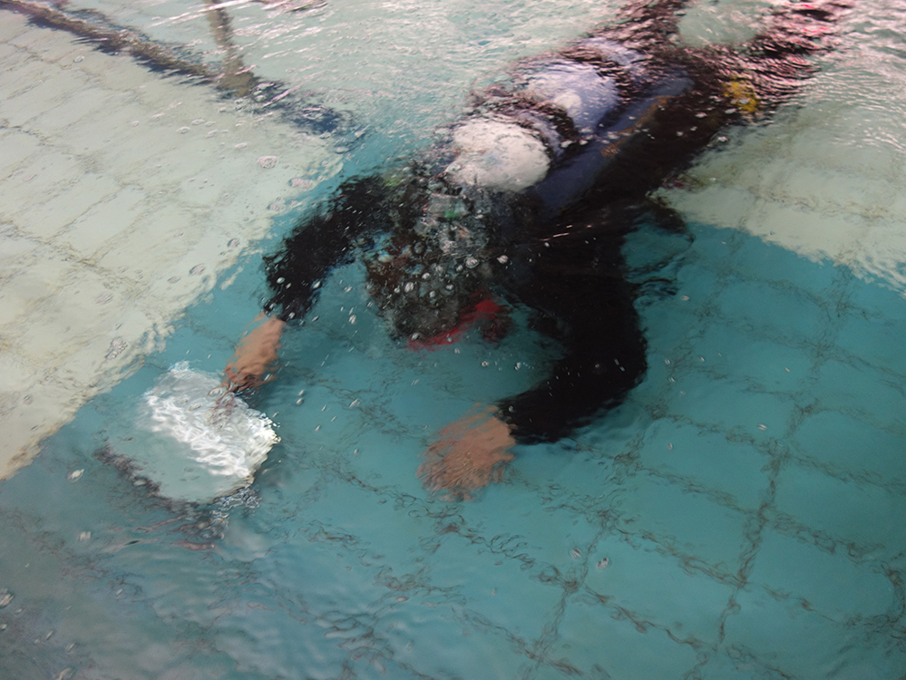 Industrial diver in swimming pool