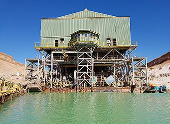 sand mining dredge at sand mine pond