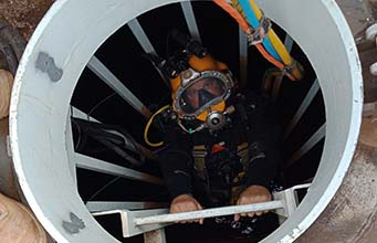 Diver accessing water tank