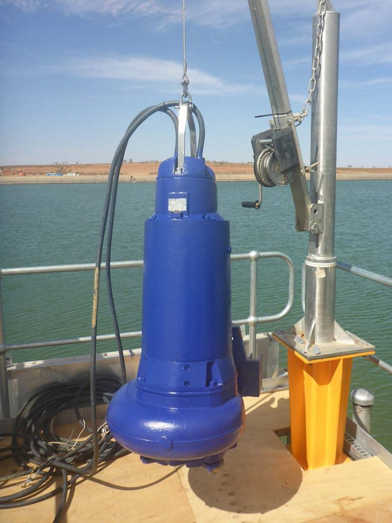 Submersible pump for bulk water storage dam installed by divers