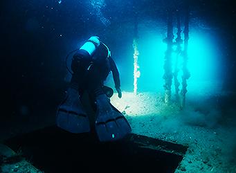 Commercial diver inside the ex HMAS Hobart