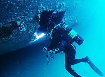 Occupational diver inspecting sunken ex HMAS Hobart