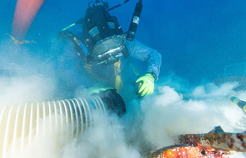 Commercial diver undertaking archaeological work