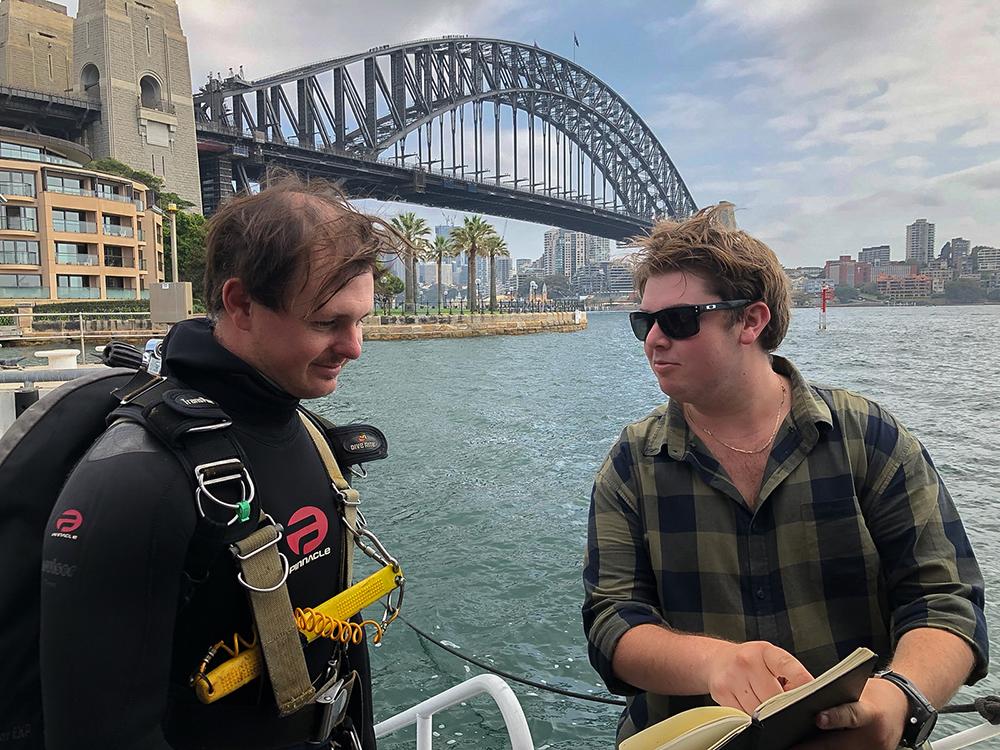 Commercial divers in front of Sydney Harbour Bridge