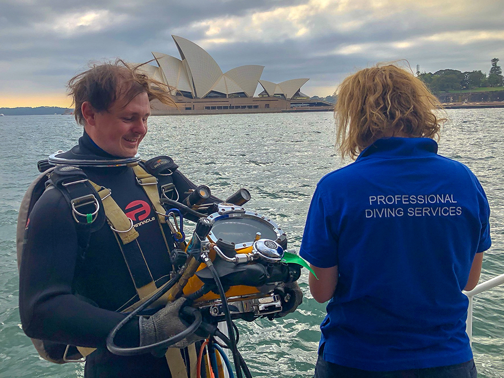 Commercial divers in front of Sydney Opera House