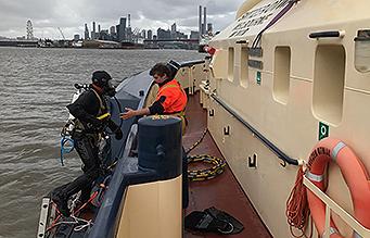 Diver on tug boat