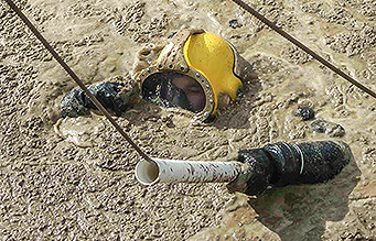 Occupational diver in sewage