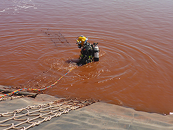 Commercial diver in mine dam