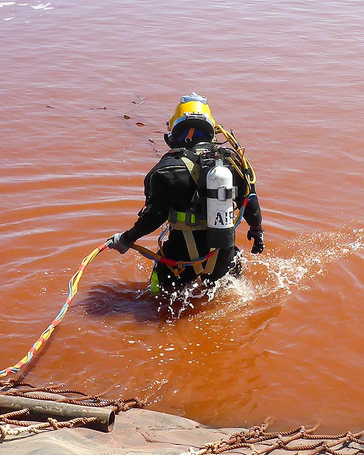 PDS diver entering a mine dam