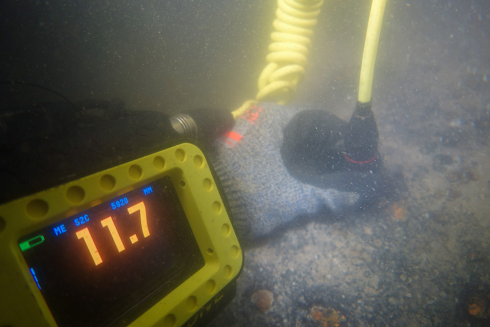 PDS diver holding non-destructive testing equipment
