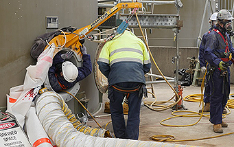 Confined space worker using smartarm