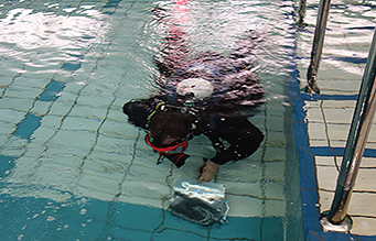 Industrial diver pool inspection
