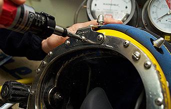 PDS Technician working on helmet