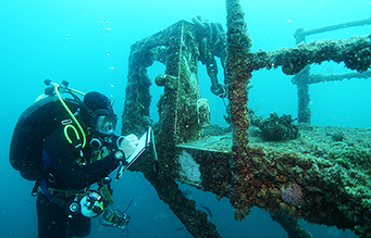 PDS diver performing a structural integrity assessment on HMAS Hobart