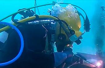 Diver welding underwater