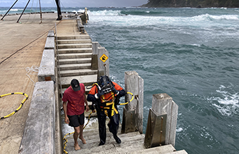 Commercial diver exiting the water at Norfolk island
