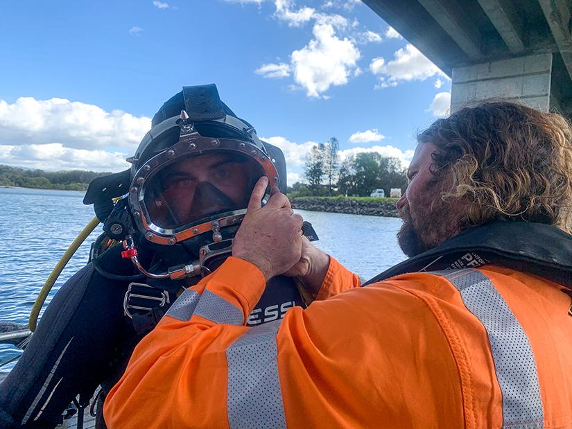Diver preparing for bridge pile survey work